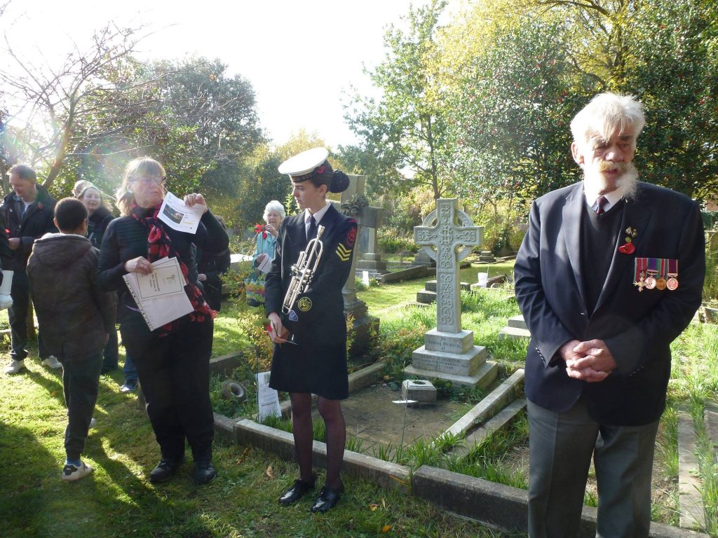 Visitors, dignatories and locals gathering in cemetery for remebrance
