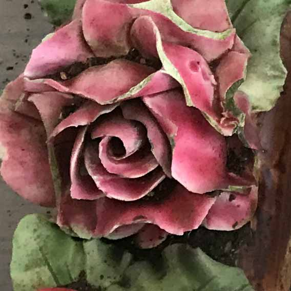 close up of one handmade pink ceramic rose